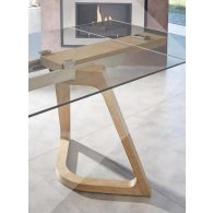Extensible table Wooden structure in ash and metal veneer Tempered glass top 10 mm.